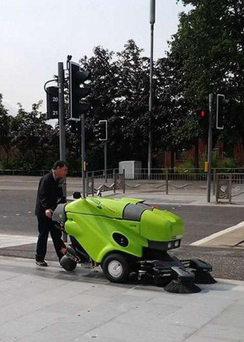Tennant-Green-Machine-400-series-footpath-sweeping-600x518